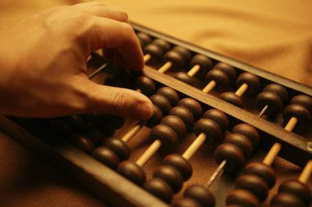 abacus-with-hand